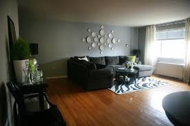 green living room paint  black couches and blue gray paint living room remodeling ideas with r