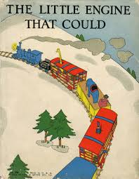 "A picture of the 1930 cover of the book ""The Little Engine That Could."" A Multicolored train is on a snowy background with the title text"