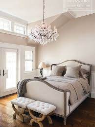 lewis and weldon french style bedroom with upholstered linen bed and ornate crystal chandelier chic crystal hanging chandelier furniture hanging