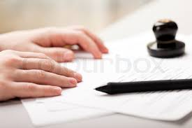 Seal stamp and pen writing business paper document   Stock Photo