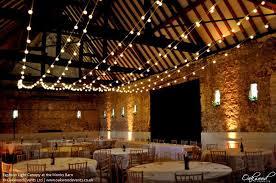 festoon light canopy at the monks barn festoon lights barn wedding lighting