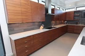 walnut cherry dining: medium image kitchen cherry wood cabinets brown varnished range hood round white pendant lighting black dining