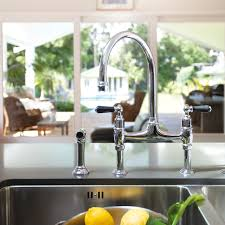 perrin rowe lifestyle: ionian deck mounted taps with lever handles and rinse perrin and rowe