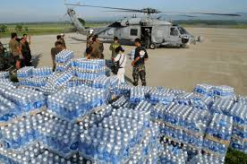 u s department of defense photo essay philippine military personnel prepare to transport bottles of water delivered by u s troops from the aircraft