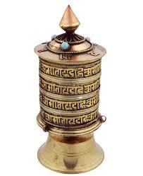 dealing feng shui: a  prayer wheel tabletop a