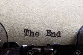 the end written on an old typewriter and old paper stock photo stock photo the end written on an old typewriter and old paper