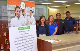 tampa based pharmacy chain specializes in customer service com the staff at benzer pharmacy left to right are pharmacist trang nguyen pharmacy