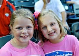 Best friends Ashlyn and Madeline enjoy the game - Creech-Skeeters-Harris-Hines