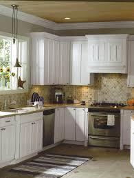 kitchen island granite top sun: kitchen traditional kitchen countertop white kitchen cabinets stainless steel appliances light wooden ceiling grey flooring