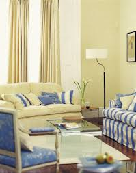 space living room olive: a pale butter yellow and cornflower blue living room with rich hardwood flooring and