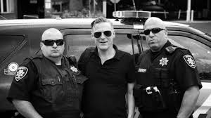 Singer <b>Bryan Adams gets</b> a lift from Suffolk sheriffs after car problems