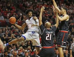 josh jackson s late throw caps 31 point day propels ku past brad tollefson ap kansas josh jackson passes the ball around texas tech s anthony livingston 21 and zach smith 11 during saturday s game in lubbock