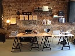 workers can quickly discuss ideas without partitions and share opinions and provide quick design critiques on cool office space idea funky