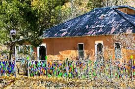 new mexico home decor: tin roof bottle fence fine art photograph southwest new mexico southwest photo