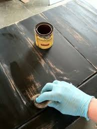 sand paint sand distress a piece of furniture rub stain into the sanded distressed areas finish with spray can of shellac antiquing wood furniture