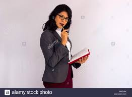 Stylish woman in <b>business suit</b> with <b>notebook</b> and <b>pen</b> in mouth ...