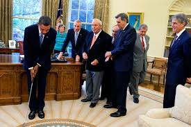 filebarack obama takes a practice putt in the oval officejpg fileobama oval officejpg