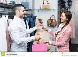 shop assistant helping customer at clothes shop stock images happy customer shop assistant royalty stock photos