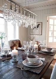lighting in rooms. neutral dining room white cream dishes candels bird print chandelier fur lighting in rooms
