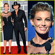 Tim McGraw and Faith Hill walk the red carpet at the 2013 Grammy Awards on Sunday (February 10) at the Staples Center in Los Angeles. - tim-mcgraw-faith-hill-grammys-2013-red-carpet