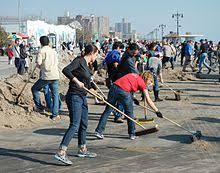 volunteering   wikipedia volunteers sweep the boardwalk in brooklyn after the  hurricane sandy volunteering