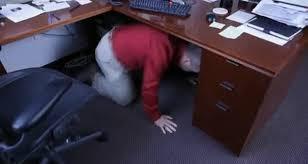 Image result for people hiding under their desks