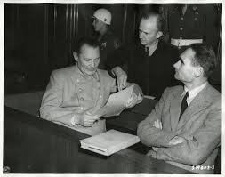 17 best images about hcc~nuremberg trials military tribunals on goering and admiral doenitz confer on a document while on trial at nuremberg rudolf hess
