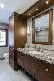 bathroom remodel dark brown cabinets custom soffit with built in lights framed mirror bathroom vanity lighting remodel custom