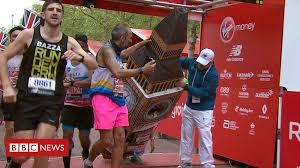 London Marathon: <b>Big Ben</b> runner gets stuck at finish line - BBC News