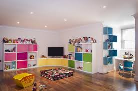 cheerful kids room storage ideas in colorful paint furnished with black flatscreen tv and completed with kids toys astounding picture kids playroom furniture