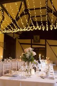 lovely warm white light canopy for a barn wedding barn wedding lighting