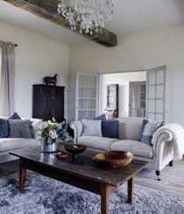 french living room furniture decor modern: modern luxury french sitting room given a rustic chic edge with antique table and cabinet