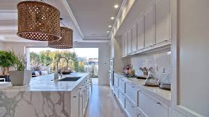 calacatta marble kitchen waterfall: fabulous kitchen with jarrod large pendants over calcutta ora marble waterfall center island across from concealed range hood hidden behind faux cabinets