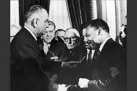 voting rights act of at    a law     true to our principles        u s  president lyndon b  johnson hands a pen to civil rights leader rev