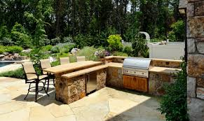 patio outdoor stone kitchen bar: outdoor kitchen with split level stone bar top