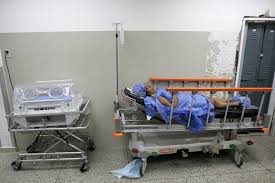 photos venezuelans contend food medicine shortages as low a w lays on a hospital bed out sheets as she recovers after labor at a