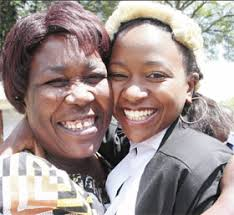KTN Anchor Esther Arunga hugs her mother Petroline Arunga at the Nairobi Law Courts Thursday moments ... - news_01042009_02