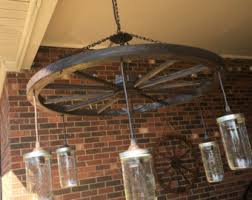 wagon wheel chandelier with mason jar lights alternating length wagon wheel mason jar
