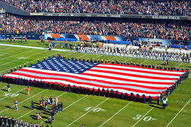 u s department of defense photo essay service members unfurl the ational flag during ceremonies before the start of sunday s football game between