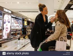 s assistant applying makeup to customer nordstrom department stock photo s assistant applying makeup to customer nordstrom department store downtown seattle washington state usa