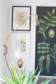 diy project idea to try make a brass swing light hello lidy apartment therapy cb2 swing arm brass wall