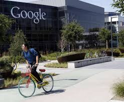 top tech firms hire asians as engineers not executives sfgate file in this 5 2014 file photo a worker rides a bike