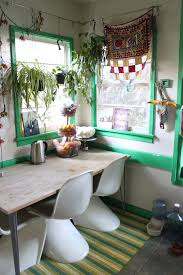 the jungalow inspiration for an eclectic dining room remodel in los angeles with white walls amazing office plants