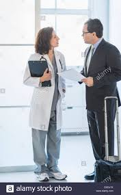 pharmaceutical representative talking to female doctor stock photo pharmaceutical representative talking to female doctor