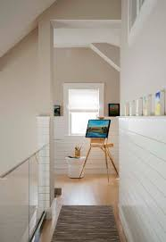 chatham retreat example of a coastal hallway design in boston with beige walls and light hardwood chatham home office decorator