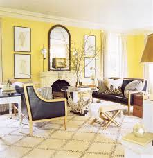 chic large wall decorations living room: decoration chic living room with yellow wall paint large framed mirror wall decor wing black leather