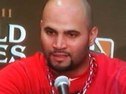 Meet Albert Pujols, new master of the understatement. After slugging a record-tying, yet otherwise meaningless, three home runs on Saturday night, ... - Albert-Pujols-press-conference