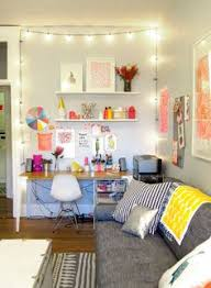 bright happy workspace love the strung lights and the artwork taped on the wall bright basement work space decorating