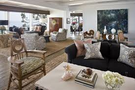 contemporary beach home example of an expansive trendy living room design in orange county with white buy living room