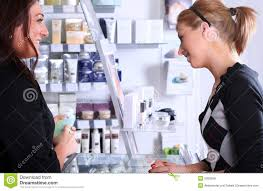 w paying through credit card at hair salon stock photo image receptionist talking a customer royalty stock image